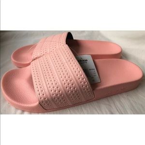 c6f4c01249c70c adidas Shoes - Adidas Originals Adilette Slides Haze Coral BA7538